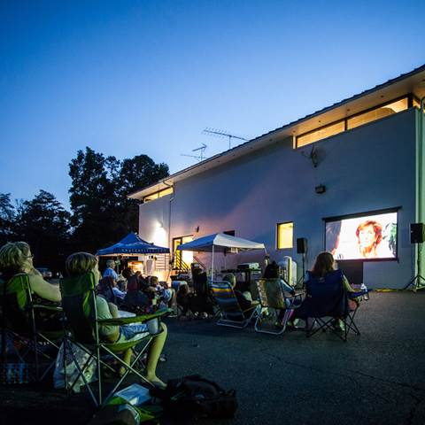 Our employees and their families kick back during outdoor movie night at our headquarters.